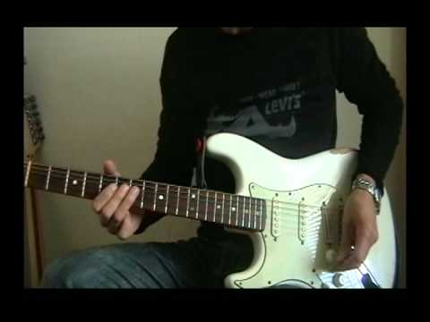 Left handed guitarist playing both left and right handed guitars