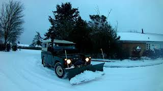 Series Land Rover plowing Snow