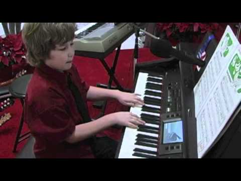 Cole (Foreverland student) playing the Piano and Guitar/