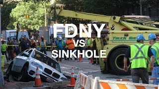 FDNY PULLS CAR OUT OF SINKHOLE ON UWS, NEW YORK CITY