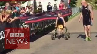 Bailey Matthews, 8, with cerebral palsy completes triathlon - BBC News