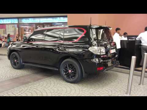 all black Nissan Patrol LE with red applications