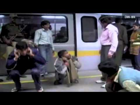 Men beaten off women's train in India