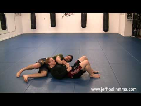 MMA Technique - 1/2 Guard Kimura and Grip Break Technique Image 1