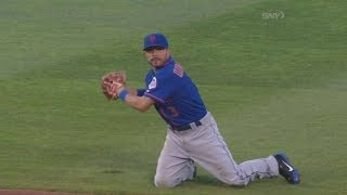 Quintanilla throws from his knees to first