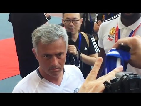 Jose Mourinho Looks Less Than Impressed When Asked To Sign A Chelsea Shirt In China