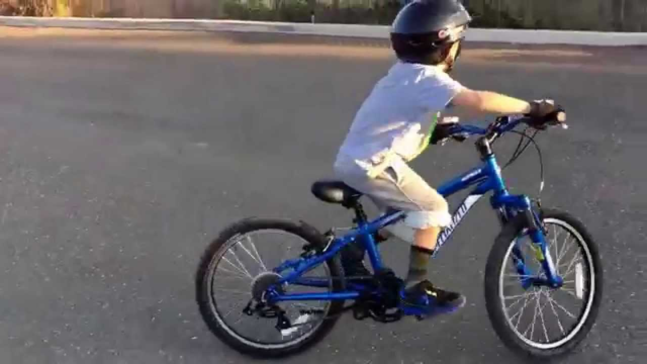 5 Year Old Mountain Biker year old climbing curbs on