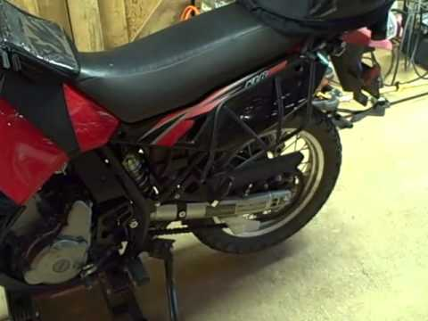 Motorcycle Repair: How to adjust the rear suspension preload on a 2009 Kawasaki KLR650