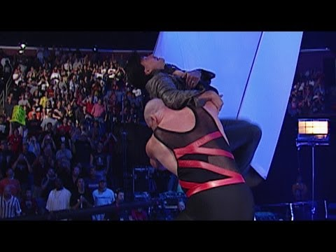 Kane chokeslams Eric Bischoff off the stage