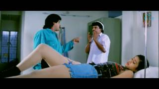 Doctor giving patient injection in navel