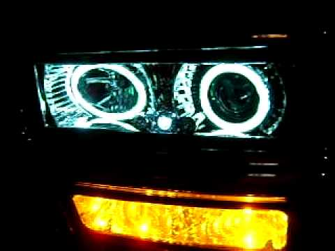 CLEAR CHROME PROJECTOR HEADLAMPS W/HALO 94-99 CHEVY/GMC TRUCKS. (WWW.CARiD.COM).