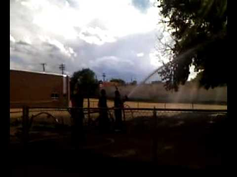 Denver Denison Montessori School playground fire - spraying tree