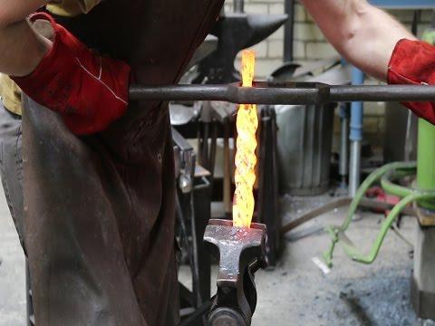 Forging a damascus dagger.