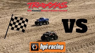 DRIVING THE TRAXXAS BIGFOOT MONSTER TRUCK RACE VS HPI WHEELY KING ROCK CRAWLING AND CRASHING