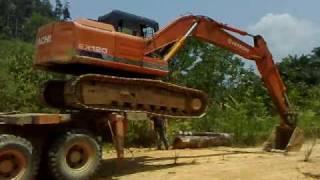 Extreme Maneuver - Unloading the Excavator
