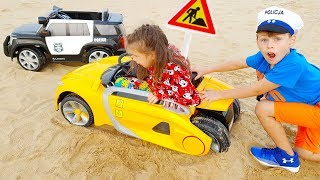 Ali and Adriana Ride on Power Wheels Children's Car STUCK IN THE SAND, funny videos for Kids