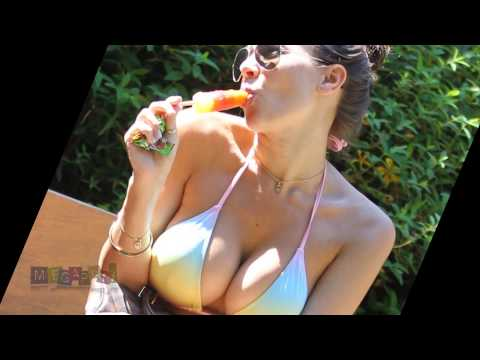 Imogen Thomas Bikini top Hot Sucking ice-lolly in a park. July 24, 2012