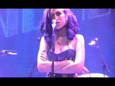 Amy Winehouse Falls Over, Forgets Words, And Mumbles Her First Performance Out O