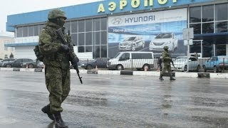 Ukraine, 'Invasion' at airport is by Russian forces     2/28/14