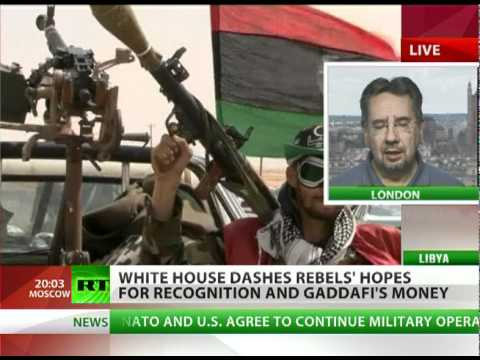 Aid with Strings: 'Libya invasion goal to corrupt & control revolution'