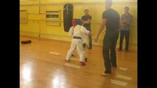 Kyokushin karate low kick...10 years old boy