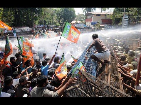 BJP Yuva Morcha activists protest demanding Oomen Chandy's resignation