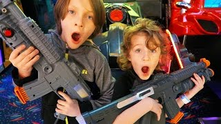Emrick & Elias Play Laser Tag, Race Cars, Zombies, Eat Pizza, Bowling, Friends | BeAHero Family Vlog