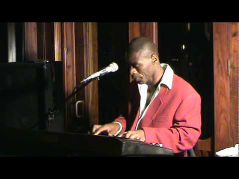 Shauri Yako (Zaire) Welly Wellington performing in Kasane Mowana Lodge Botswana