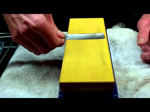 straight razor sharpening using alternating x strokes on norton 8000 grit whet stone