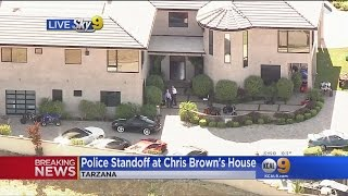 Police Swarm Nig Rapper Chris Brown's Home After Woman Reports Assault