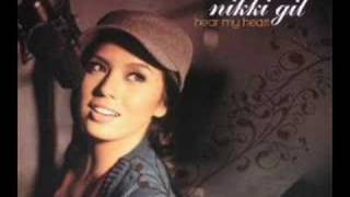 Watch Nikki Gil Million Miles Away video