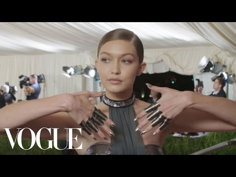 Gigi Hadid on Her Futuristic Bathing Suit and Chrome Knuckles | Met Gala 2016