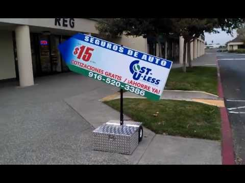 Robotic 39 wavers 39 cutting in on human sign twirlers for Motorized sign waving mannequin