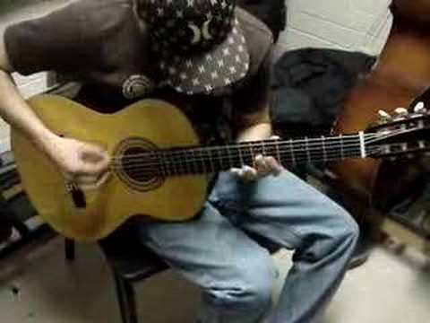My friend jamming out in guitar class... Its just sick, he made this all up. The tuning is dropped D.
