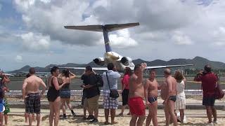 Wife recording jet blast but gets way too close in St. Maarten
