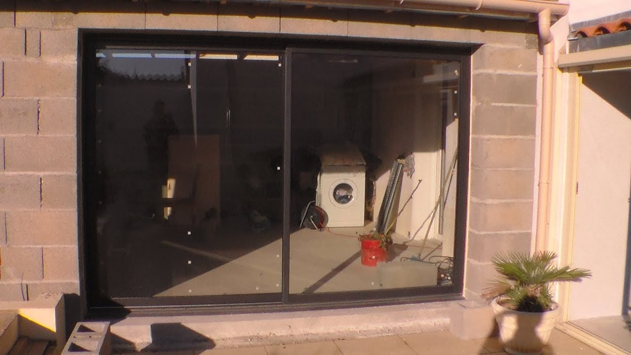 Comment poser une baie vitr e how to put a bay window for Baie vitree pour porte de garage leroy merlin