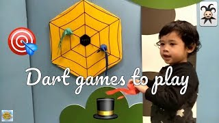 Kids playing with toys and concentration game using dart games to play
