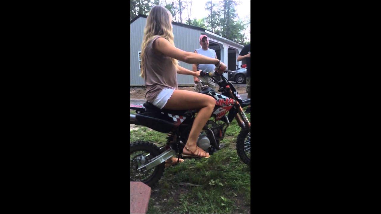 naked girl riding a dirt bike