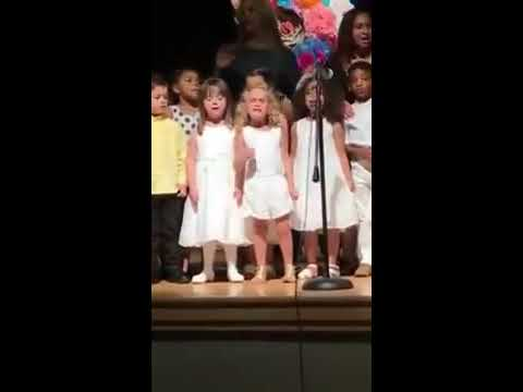 Little girl owns stage at preschool graduation