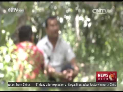 China's anti-terrorism efforts -- Two farmers return to family from illegal past
