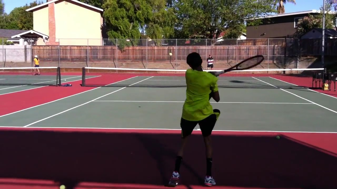 how to hit heavy topspin serve