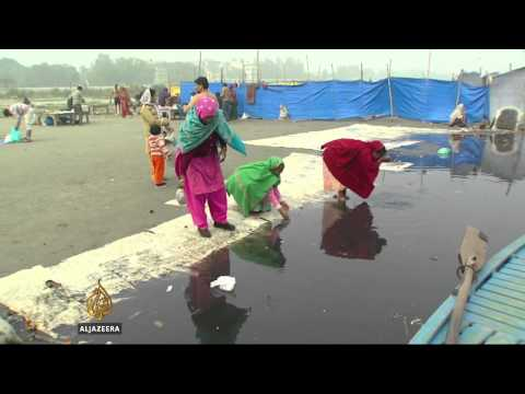 Devotion suffocates India's sacred Yamuna river