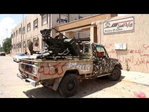 Libya gunmen besieging ministries demand govt quits