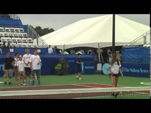 Boys and Girls from Kutsher's Sports Academy hitting with Leander Paes