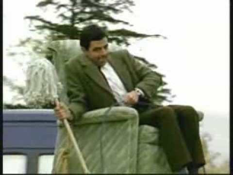 Mr Bean drivin a car on the roof