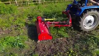Reclaiming land (harvest site) with a flail mulcher and foton tractor