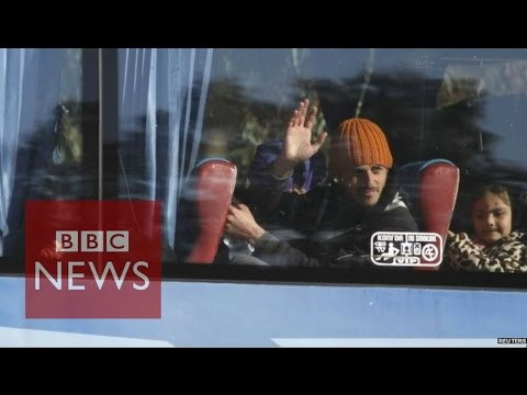 Syria conflict: Inside Homs as fighters and families leave city - BBC News