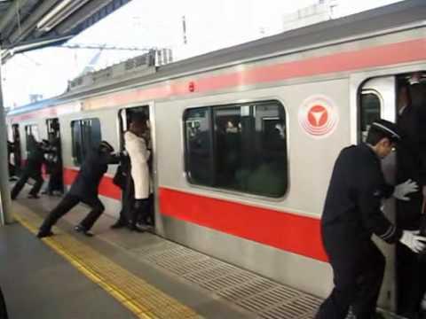 People stuffed onto a train in Tokyo, Japan (train ...