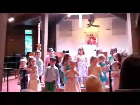 Prince of Peace preschool kids in NJ are singing on the graduation.
