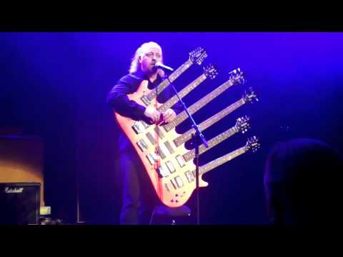 Bill Bailey playing his 6 neck guitar